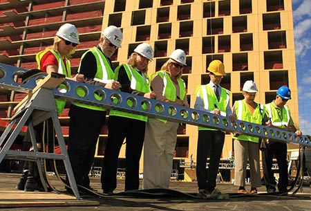 Photo of officials at the Lake & Forest project topping-off ceremony